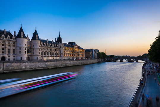 Cruise ship in Seine river against clear blue sky during sunrise, Paris, France