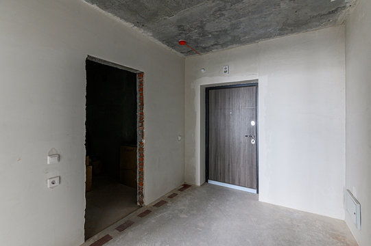 Russia, Moscow- February 10, 2020: interior room apartment rough repair for self-finishing. interior decoration, bare walls of the premises, stage of construction