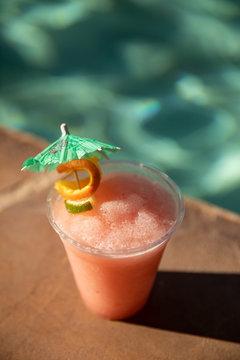 Frozen strawberry margarita poolside at a resort