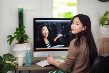 Asian student under e-learning at home with he teacher