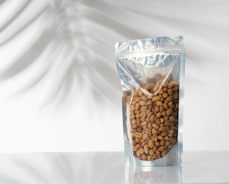 blank standing pouch mockup with nuts on transparent window