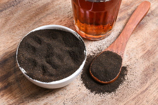 Indian Masala Chai black tea and tea dust,traditional beverage with or without milk and spices Kerala India. Two cups of organic ayurvedic or herbal drink India, good in winter for immunity boosting.