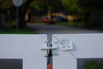 Sticky Note at Local Park Encouraging People to Help Seniors During the Pandemic