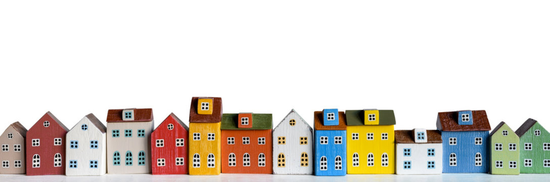 Row of wooden miniature colorful retro houses on white background