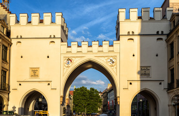 Fototapete - Ancient gate of Karistor in Munich, Bavaria, Germany. Front view of restored medieval gate of Munich at sunset.
