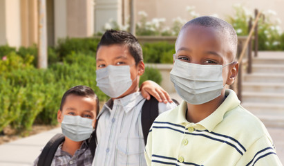 Young Students on School Campus Wearing Medical Face Mask During Coronavirus Pandemic
