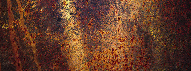Panoramic grunge rusted old metal texture. Rusty corrosion and oxidized plate. Worn metallic iron background.