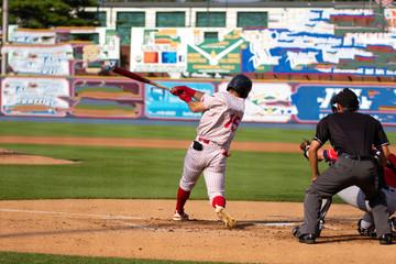 baseball players hitting