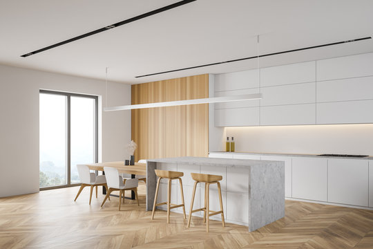 White and wood kitchen corner with bar and window
