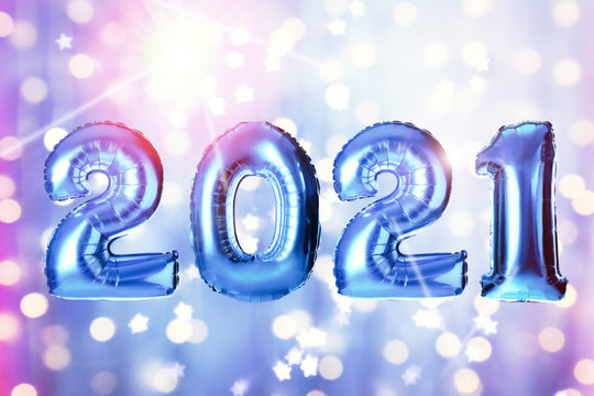 2021 New Year celebration. Creative design with bright blue balloons and blurred lights on color background