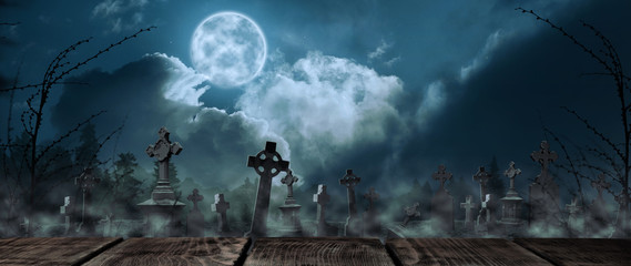 Wooden surface and misty graveyard with old creepy headstones under full moon. Halloween banner design