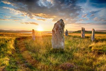 Wall Mural - Dranatic sunset over Ceann Hulavig stone circle on the Isle of Lewis
