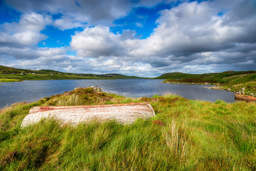 Wall Mural - An upturned boat on the shores of Loch Erisort