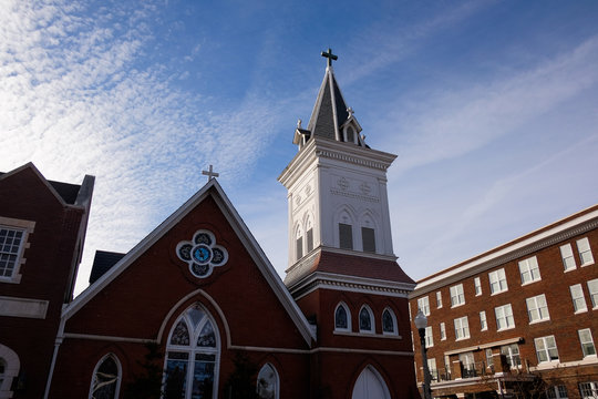 Southern Baptist church steeple with clouds and blue sky