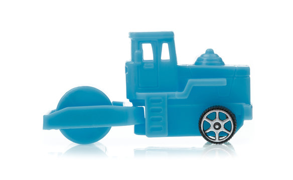 toy of wheel loader roller compactor isolated on white background
