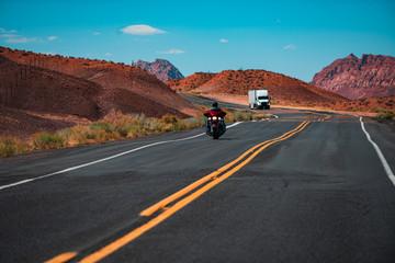 Fotobehang Route 66 Biker driving on the Highway on legendary Route 66. Long Desert Highway California. Road trip in Arizona desert.
