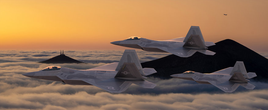 formation of the fifth generation :Lockheed Martin F-22 Raptor of the US Air Force in flight above the clouds