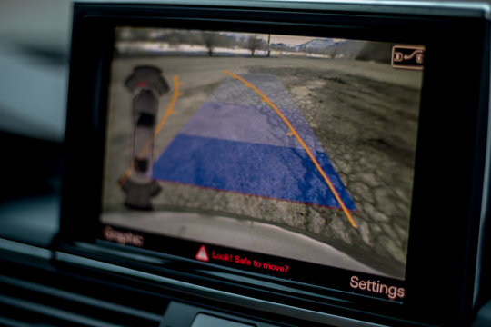 Cluj-Napoca/Cluj/Romania-08.05.2019-pop up navigation display illustrates the image taken from the rearview camera installed on a 2016 Audi A6