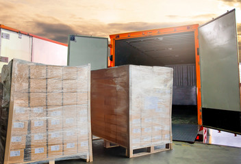 Cargo freight, Shipment, Delivery service. Warehouse docks. Stacked package boxes on pallet waiting to load into cargo container truck. Logistics and transportation.
