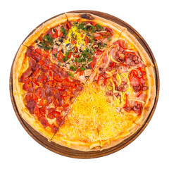 pizza with four different type of toppings. tasty quadruple italian family food on the round wooden board. isolated on the white background. top view
