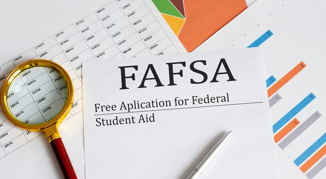 FAFSA inscription on the documents. Business concept
