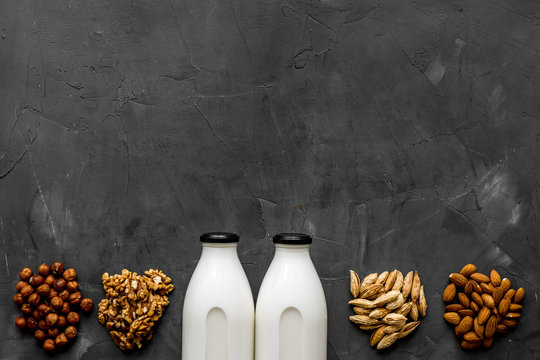 Bottles of non-dairy vegan milk - lactose free nuts and grain drink. Top view