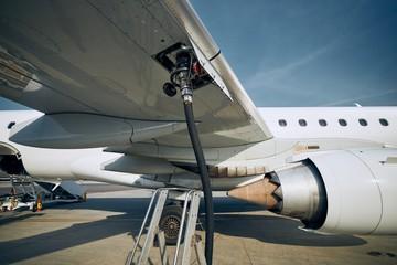Refueling of airplane Fotobehang
