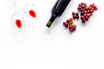 Fototapete - Red wine with grape - in glasses and bottle - on white desk top view copy space
