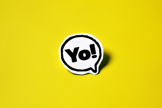 YO speech bubble on white paper isolated on yellow paper background with drop shadow. COPY SPACE.