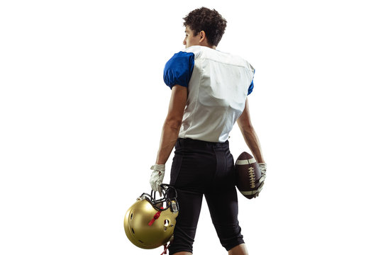 Confident posing. American football player isolated on white studio background with copyspace. Professional sportsman during game playing in action and motion. Concept of sport, movement, achievements