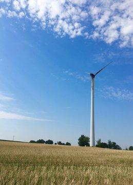 wind turbine in the field on Fire