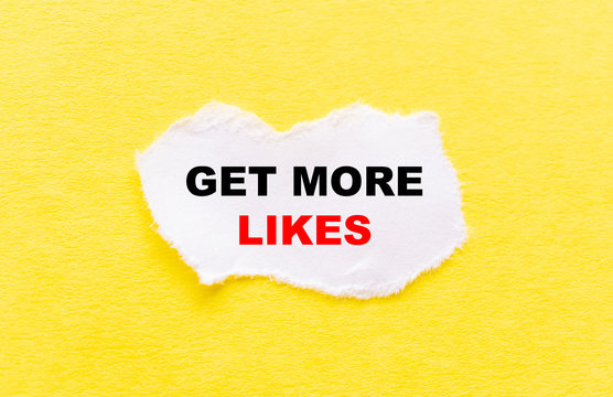 the inscription GET MORE LIKES on a white torn piece of paper on a yellow background