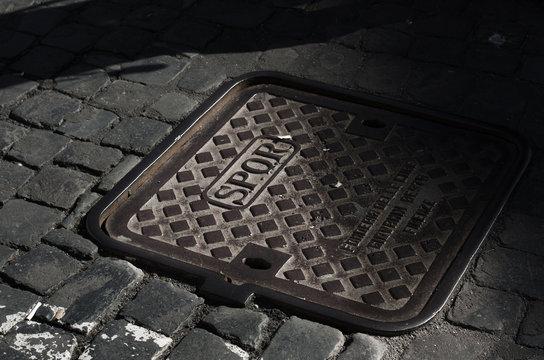 manhole with slogan SPQR in Rome