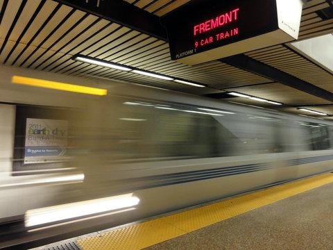 BART Train speeds into station platform
