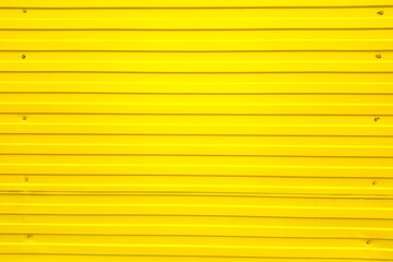 Iron corrugated fence for background texture yellow