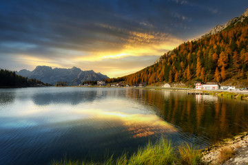 Dolomites mountains reflected in the Lago mi Misurina Lake at sunset, South Tyrol. Italy