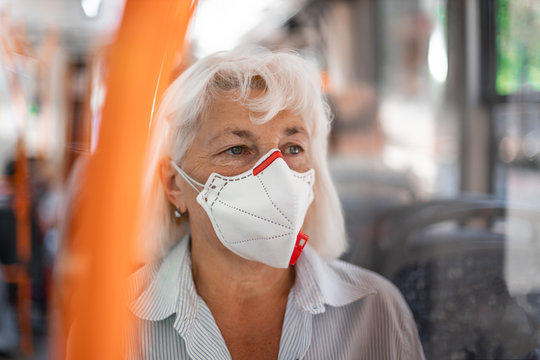 Coronavirus, covid 2019 virus protection. Woman with respiratory mask traveling in the public transport by bus