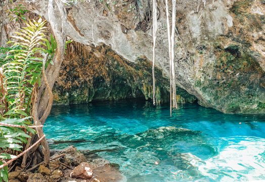Crystal Clear blue water cenote in Mexico