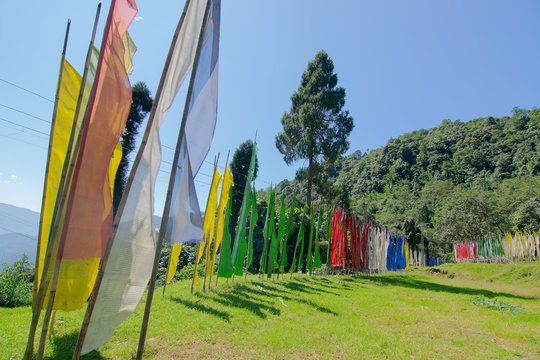 Buddhist religious flags waving in breeze , in memories of the departed souls, at Rinchenpong monastery, Sikkim, India.