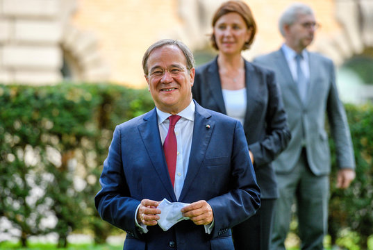 North Rhine-Westphalia's State Premier Armin Laschet smiles as he arrives for a family photo prior to a North Rhine-Westphalian cabinet meeting in Duesseldorf