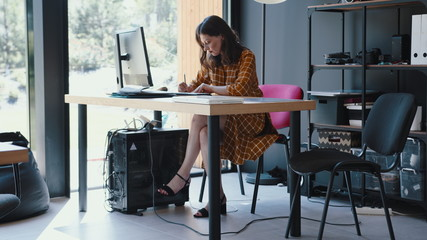 Beautiful happy 30s brunette European freelancer business woman working at modern coworking office table slow motion.