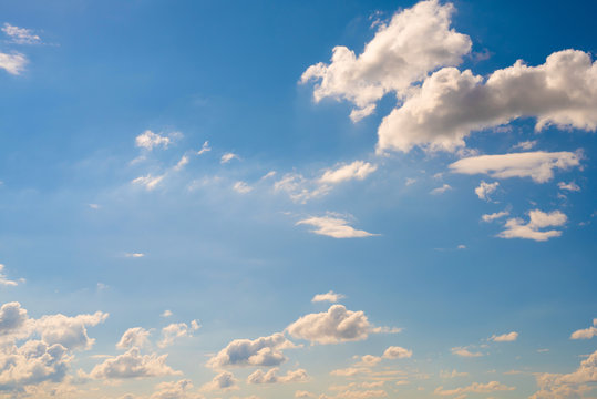 Beautiful blue summer sky with fluffy clouds
