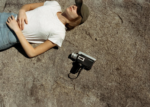 Woman laying on rock with super 8