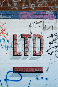 Abbreviated LTD painted on wall