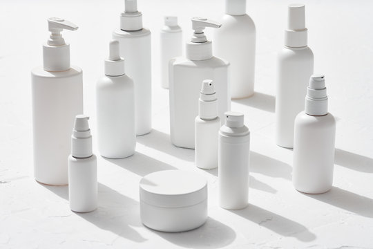 Jar with cream amidst white bottles