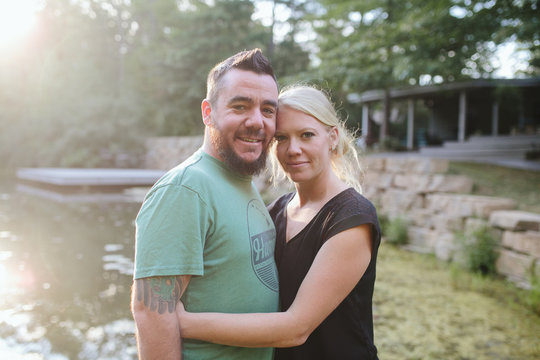 photos of couple hugging by lake