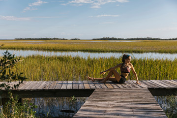 Athlete Stretching Before Run in Boardwalk Landscape