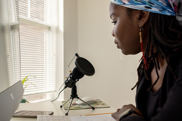 Woman recording a Podcast