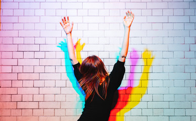 Woman dancing under colored lights