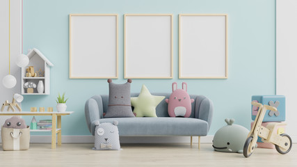 Blue sofa and doll,cute pillows in elegant child's room with posters on the wall.